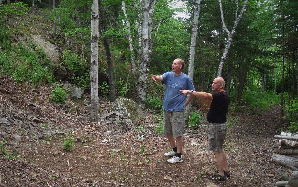 Claude-Olivier showing Jeff the 'trials-bike course' he's building