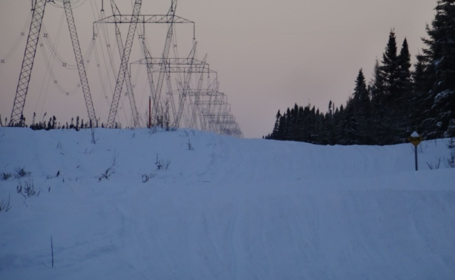 Hydro towers beside a snowmobile trail in the evening light in north eastern Ontario