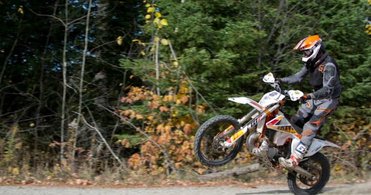 KTM dirt bike doing a wheelie