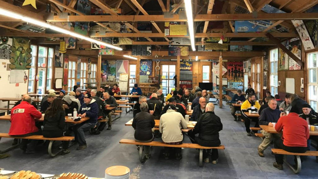 Adventure motorcycle riders eating breakfast at Horizons Unlimited Ontario
