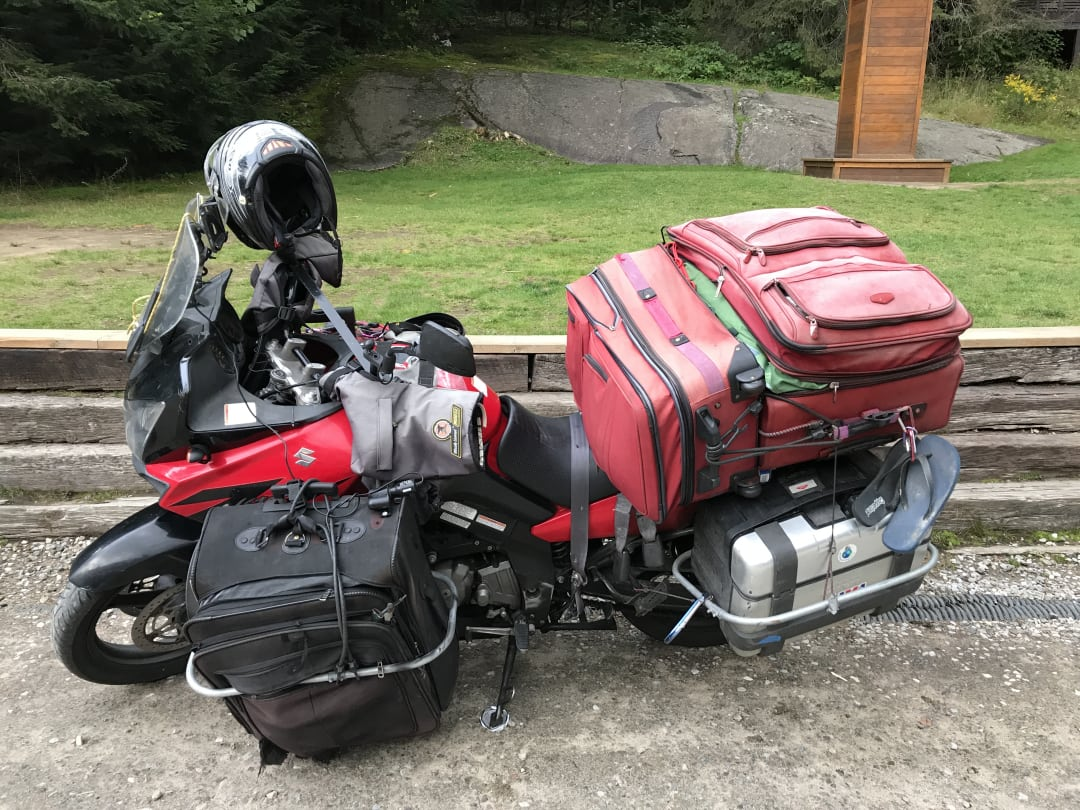 A Suzuki V-Strom heavily laden with luggage