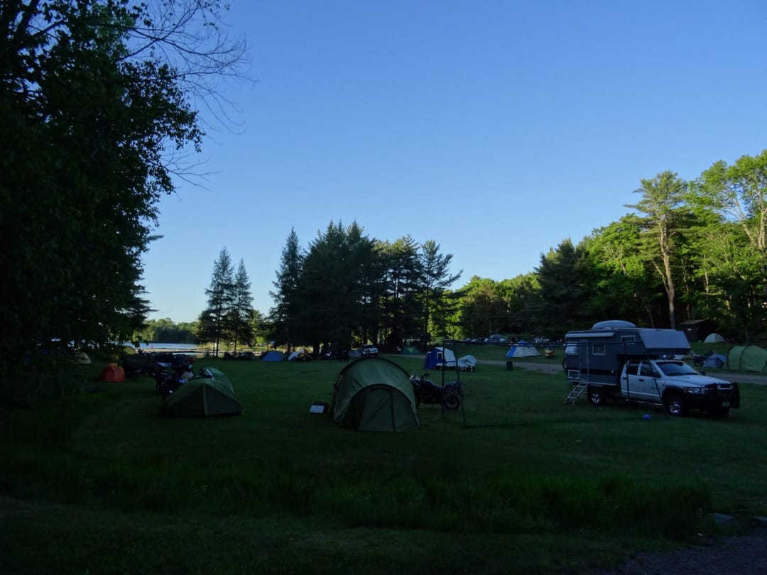 Overland travelers and tents in a camp ground in Ontario