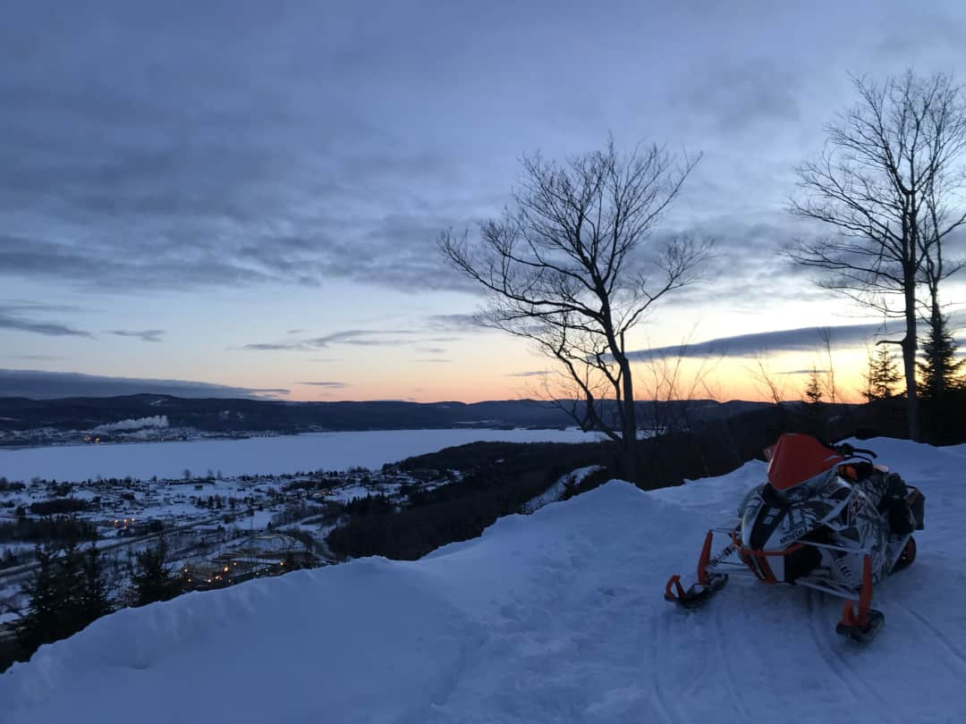 Photo of a snowmobile above Pointe-a-la-Croix at sunset