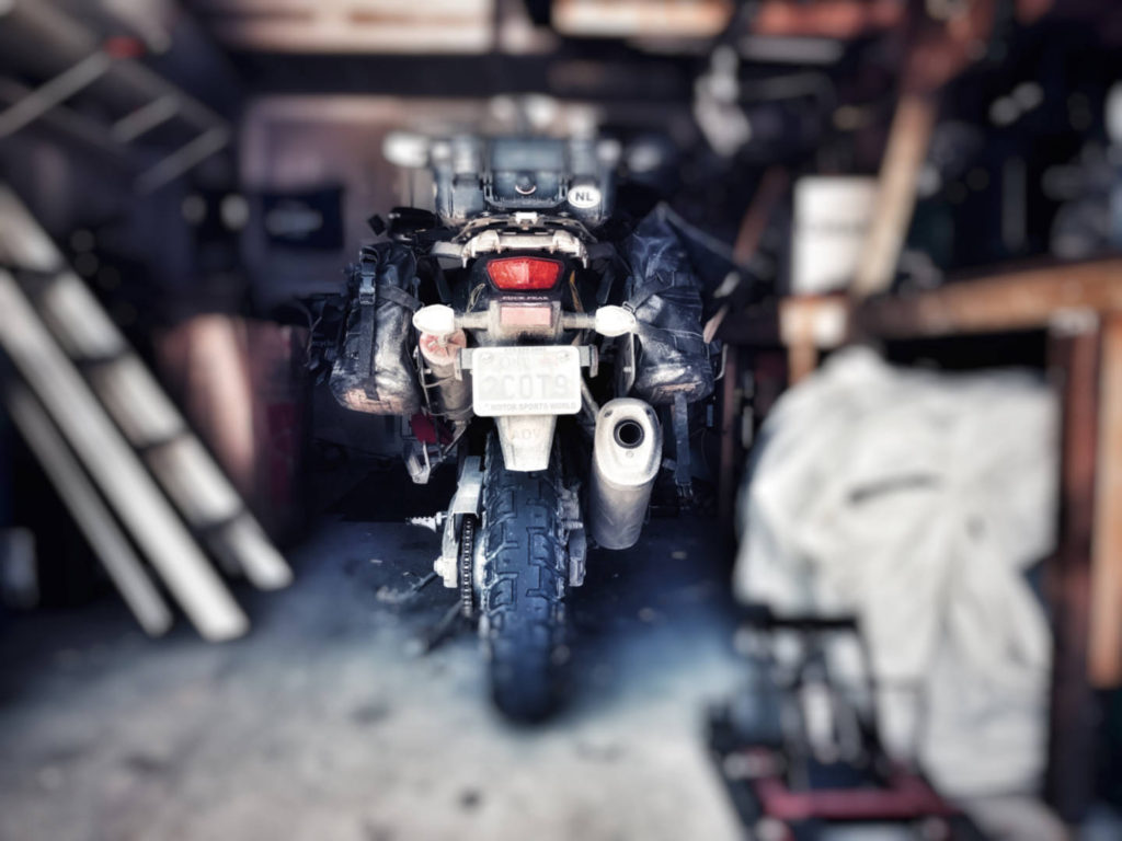 A blurry photo of a motorcycle stored in a garage