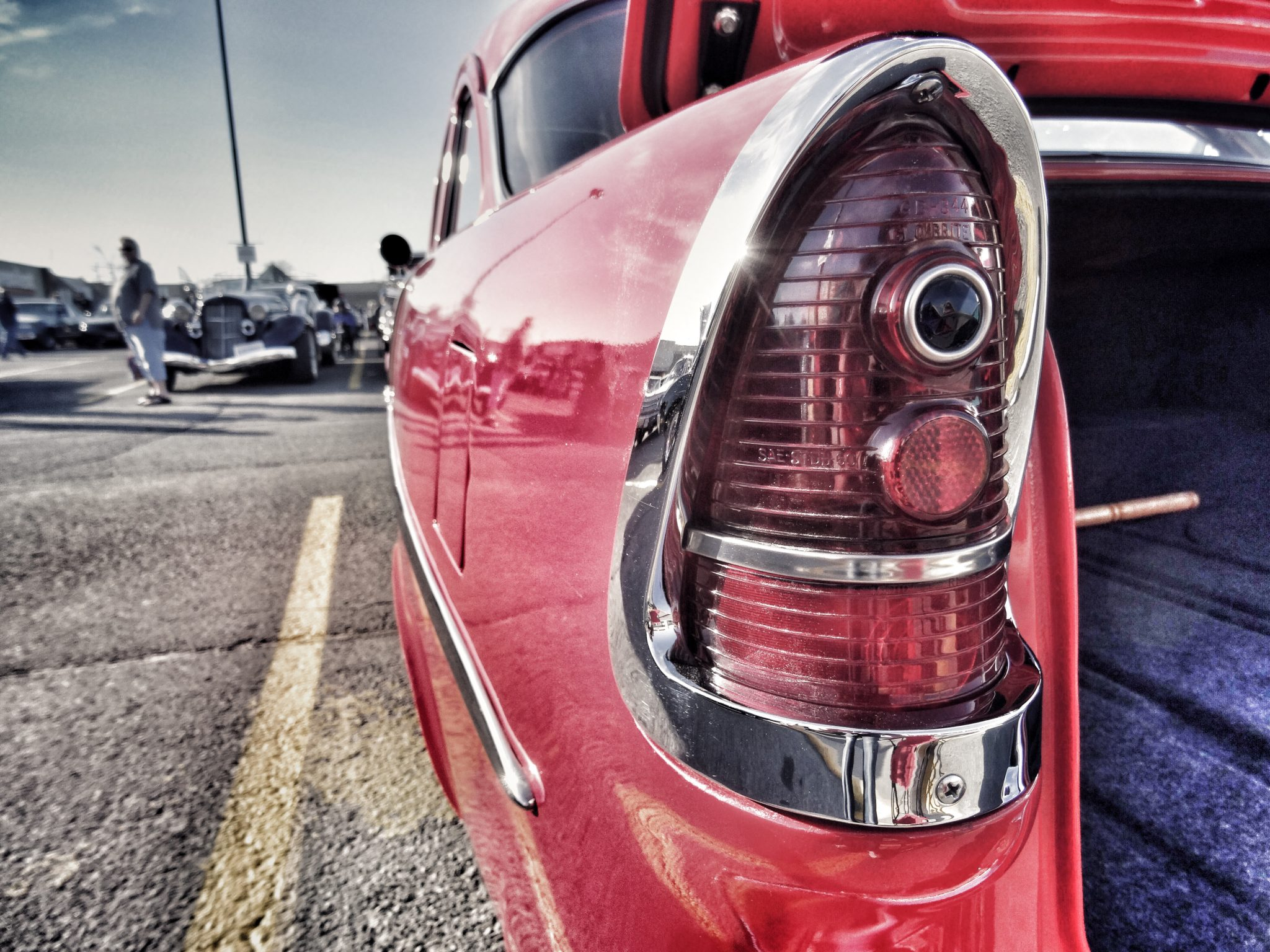 Photo of the left tail light of a 1955 Chevrolet