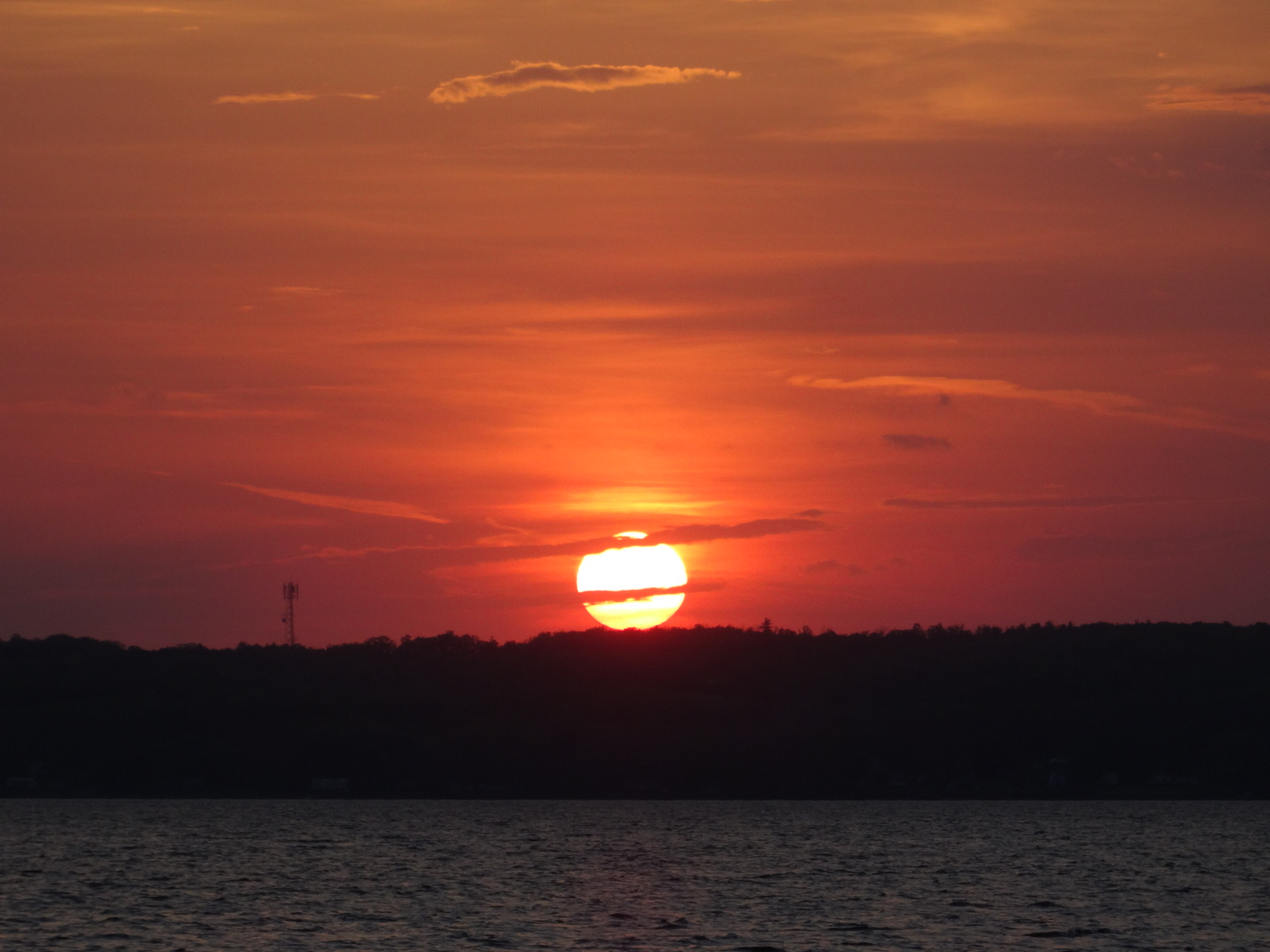 A photo of a beautiful red sunset over Rice lake at Golden Beach resort