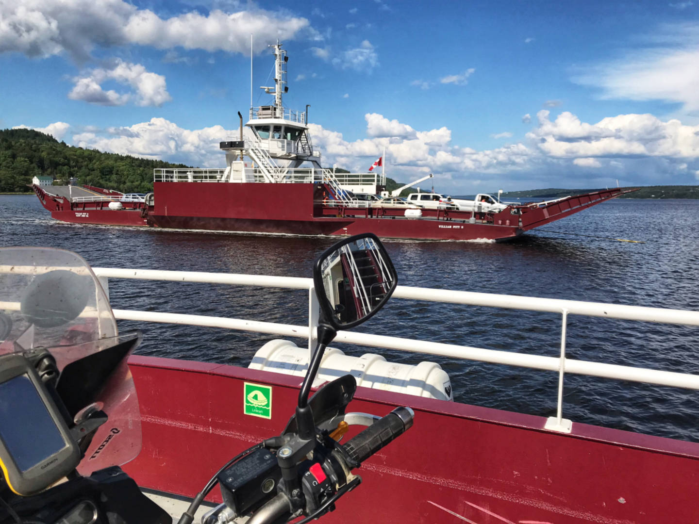 photo of two cable ferries passing on a bay in New Brunswick