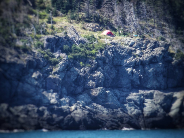a tent perched on a cliff at Hole in the Wall campground