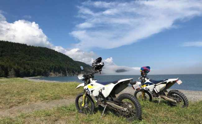 Photo of 2 Husqvarna motorcycles on Martin's Head beach, NB