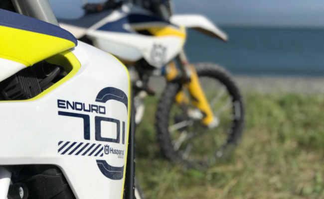 A photo of 2 Husqvarna motorcycles at Martins Head Beach, NB