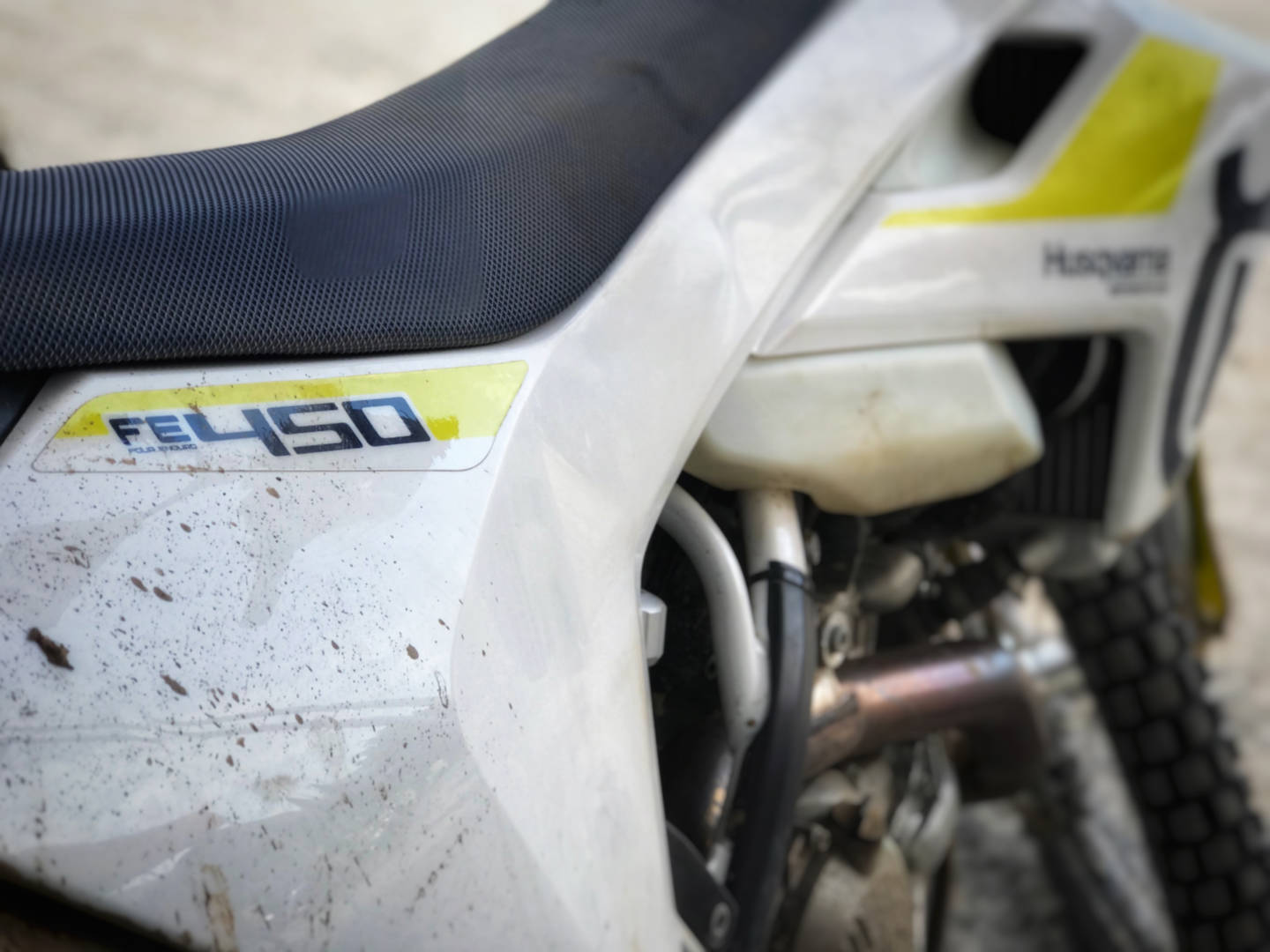 A photo of a white Husqvarna enduro motorcycle