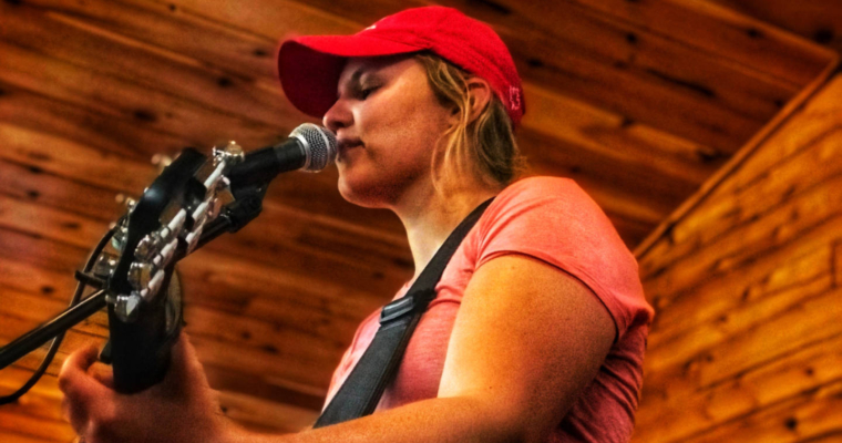 photo of singer/songwriter Kassie Tyres performing at the Fundy Adventure Rally