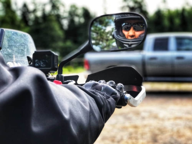 Canadian songwriter/musician Kassie Tyres refelected in her motorcycle mirror