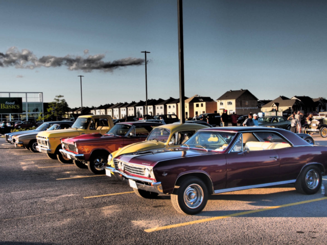 a photo of several classic muscle cars from the 1960's and 1970's taken at Kemptville Cruise Nights