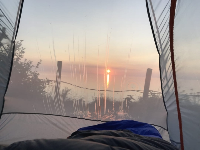 Sunrise as seen from inside of a tent at Grand Manan Island