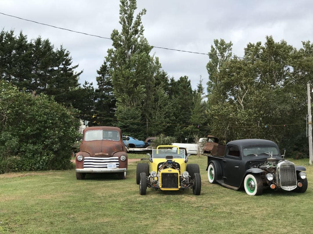 Some hot rods on a lawn near Christopher Cross PEI