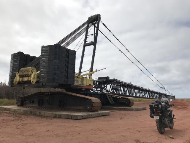 A Suzuki V-Strom in front of a huge Liebherr crawler boom crane