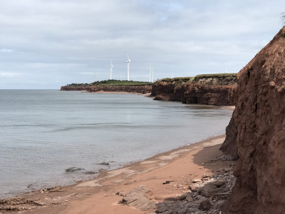 The beach and some wind turbines at North Cape PEI