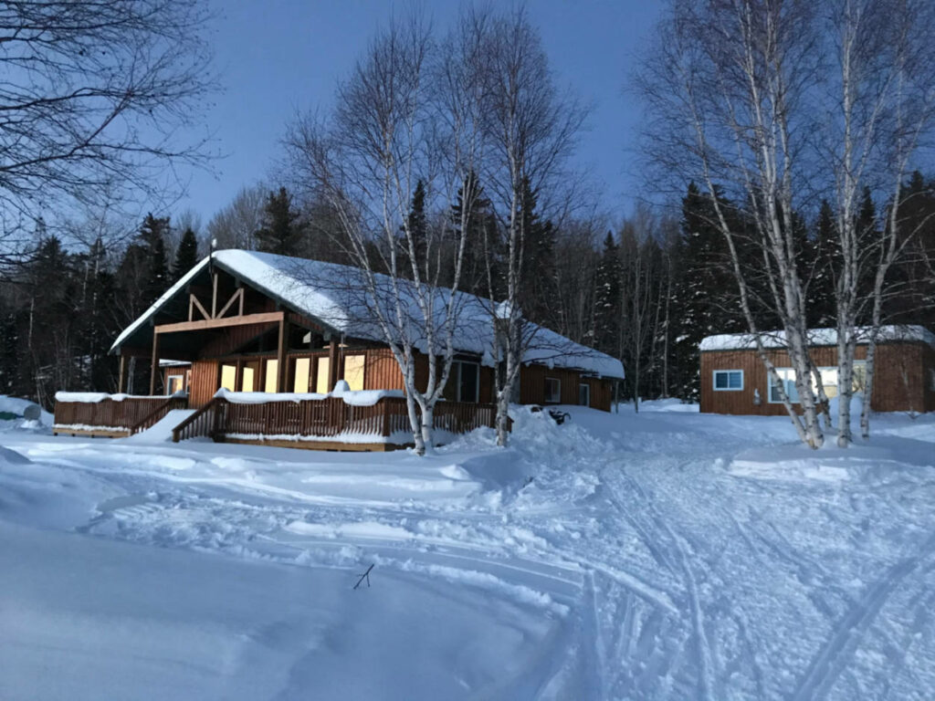 a photo of a winter scene of a chalet in Wawa Ontario