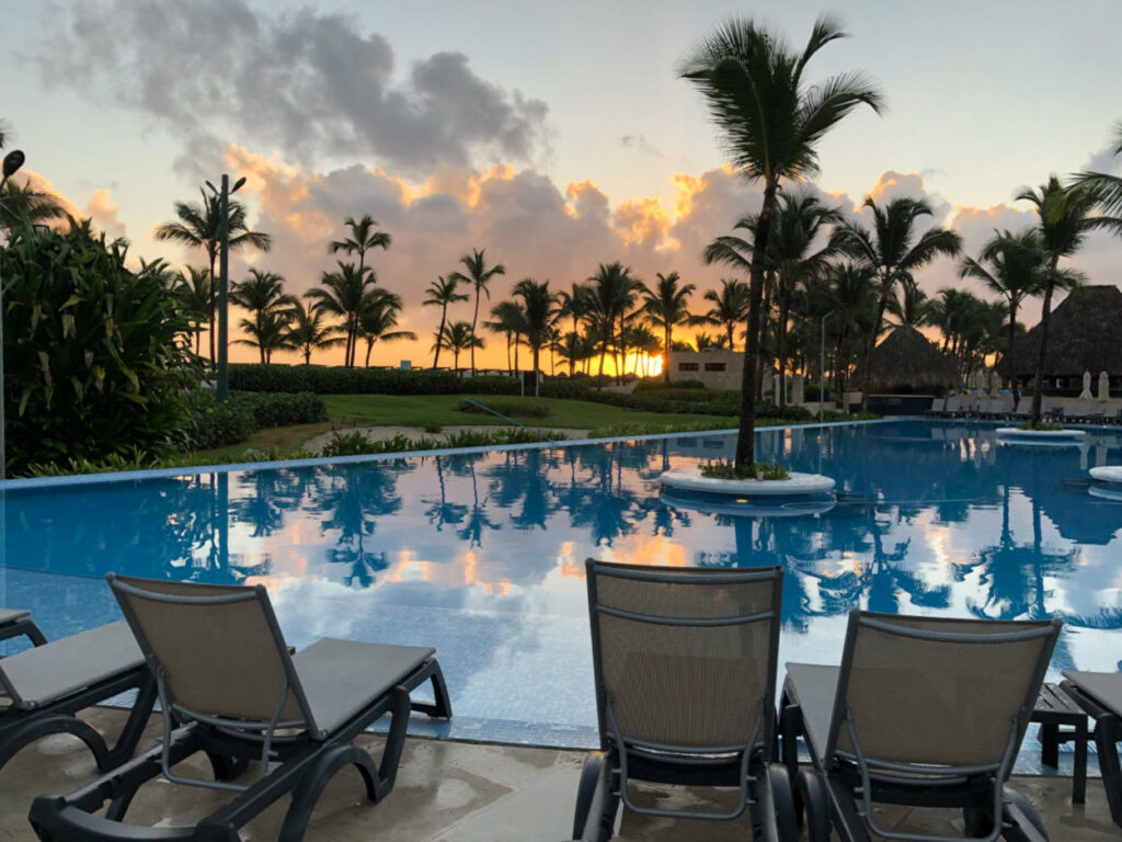 Sunrise over a resort swimming pool in Punta Cana
