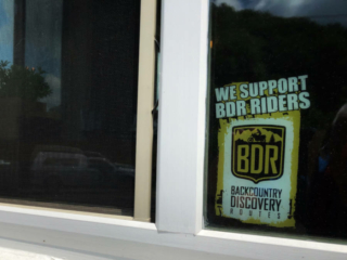 a sticker supporting the Back Country Discovery Routes on a restaurant window