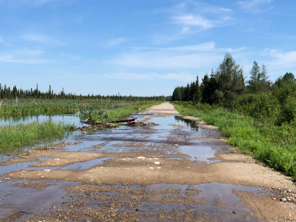 a photo of a gravel road covered in water
