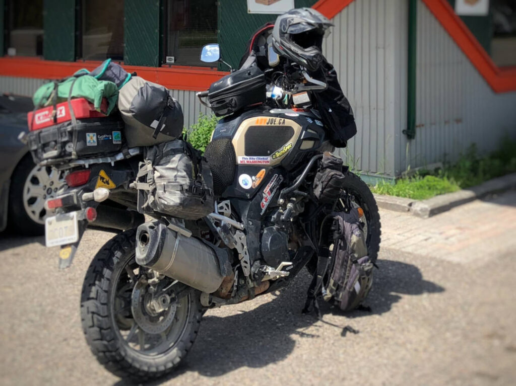 A photo of a Suzuki VStrom motorcycle packed with camping gear