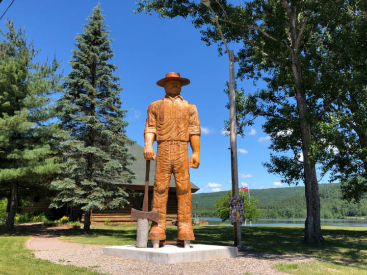 a photo of a wooden statue of Big Joe Mufferaw in Mattawa, Ontario