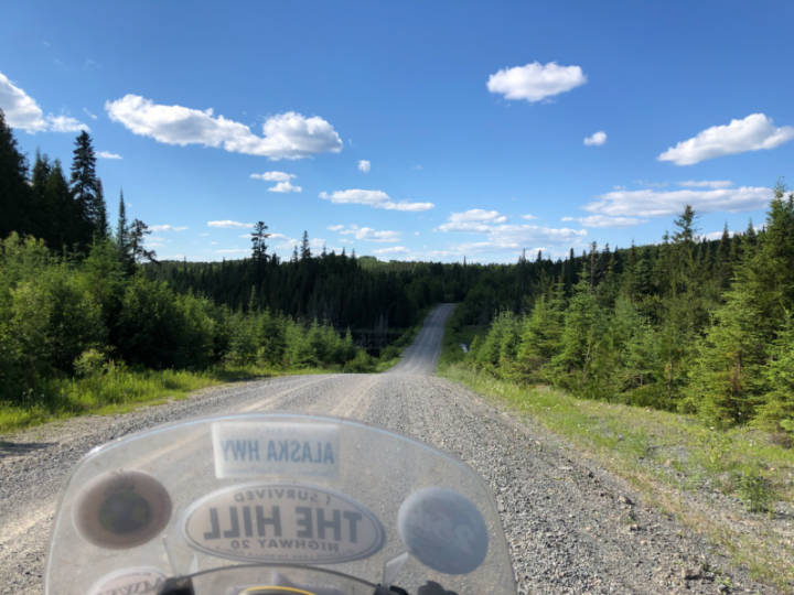 a photo of a gravel forest logging road